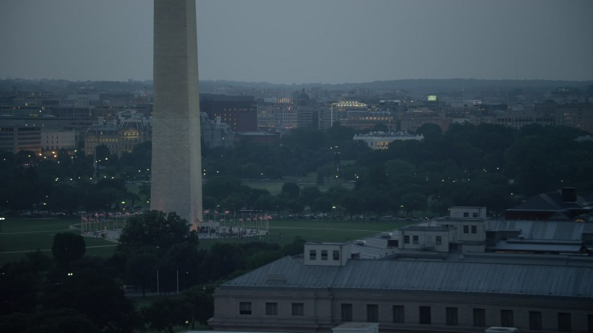 5K stock footage aerial video of the White House and the Washington Monument lit up, Washington, D.C., twilight Aerial Stock Footage | AX76_179