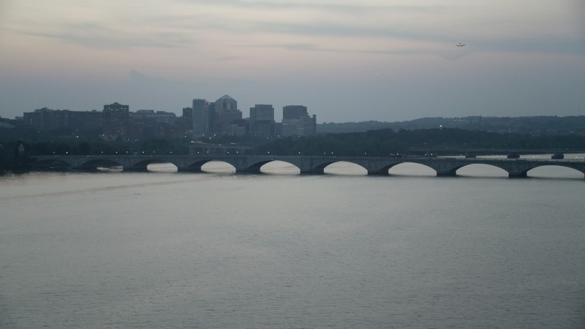 5K stock footage aerial video of Arlington Memorial Bridge spanning the Potomac River, Washington, D.C., twilight Aerial Stock Footage | AX76_180