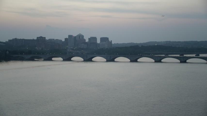 5K stock footage aerial video of Arlington Memorial Bridge spanning the Potomac River, Washington, D.C., twilight Aerial Stock Footage AX76_180 | Axiom Images