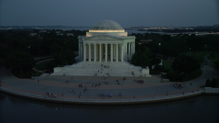 5K stock footage aerial video of the Jefferson Memorial, lit up for the night, with tourists on the steps, Washington, D.C., twilight Aerial Stock Footage | AX76_184