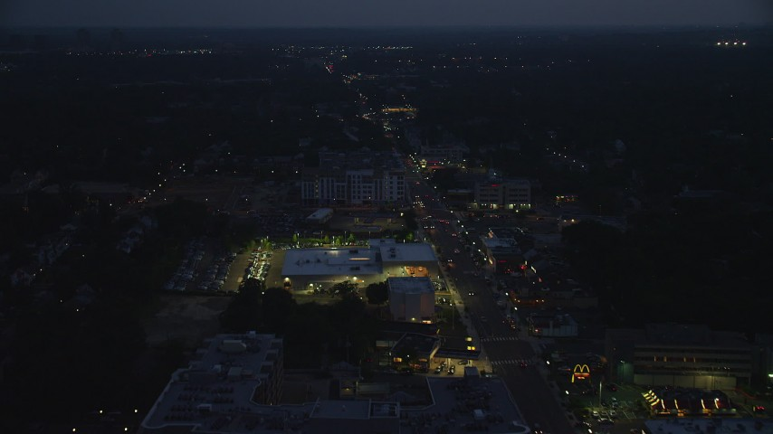 5K stock footage aerial video following Columbia Pike through Arlington, Virginia, night Aerial Stock Footage | AX76_188