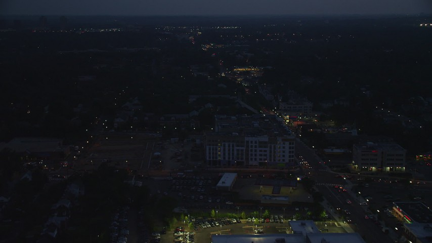 5K stock footage aerial video flying over apartment buildings and suburban homes in Arlington, Virginia, night Aerial Stock Footage | AX76_189