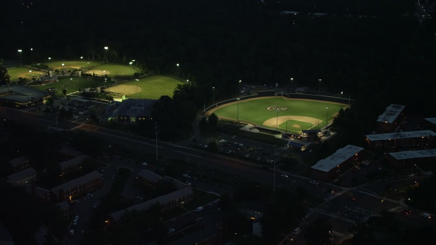 5K stock footage aerial video of baseball fields in Barcroft Park, Arlington, Virginia, night Aerial Stock Footage | AX76_190