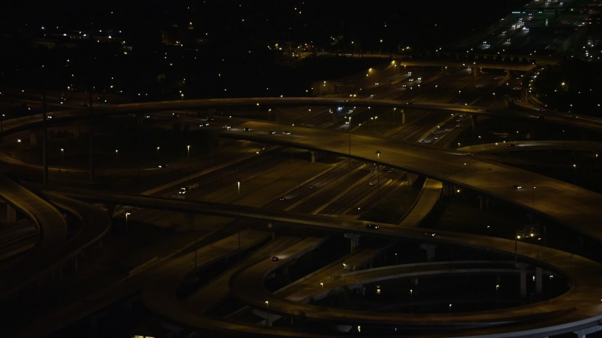5K aerial video approaching Interstate 95 and Richmond Highway Interchange, Alexandria, Virginia, night Aerial Stock Footage | AX77_009