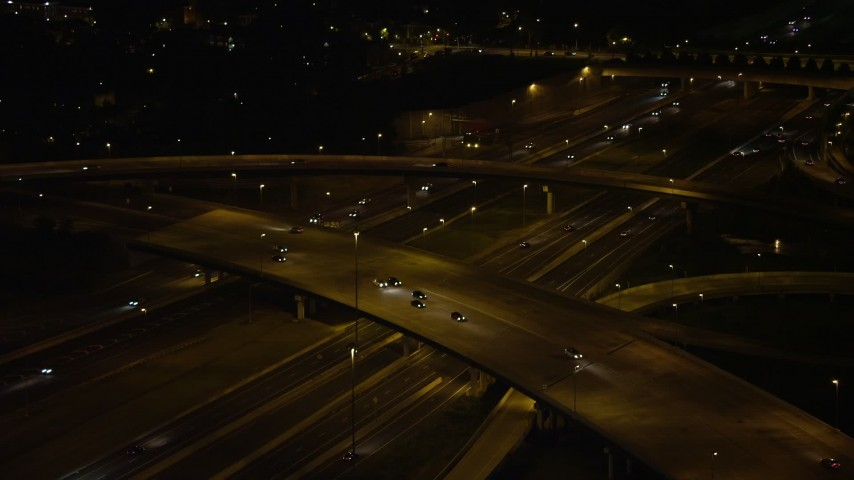 5K stock footage aerial video panning across Interstate 95 to reveal Woodrow Wilson Memorial Bridge, Fort Washington, Maryland, night Aerial Stock Footage AX77_010 | Axiom Images