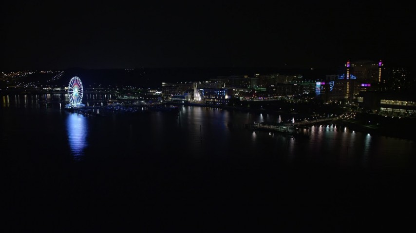5K aerial video of the Capitol Wheel, apartment buildings, and Gaylord National Resort and Convention Center, National Harbor, Maryland, night Aerial Stock Footage | AX77_013