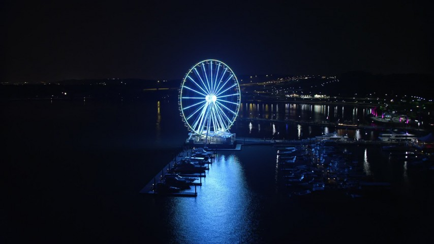 5K aerial video of the Capitol Wheel and marina, reveal Gaylord National Resort & Convention Center, National Harbor, Maryland, night Aerial Stock Footage | AX77_015