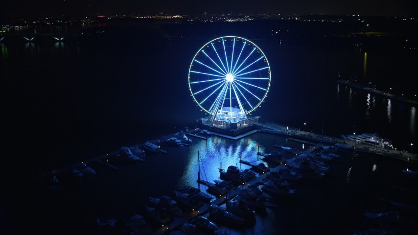 5K aerial video of the Capitol Wheel and the National Harbor Marina, Maryland, night Aerial Stock Footage | AX77_018