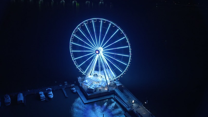 5K aerial video of the Capitol Wheel and National Harbor Marina, Maryland, night Aerial Stock Footage | AX77_019