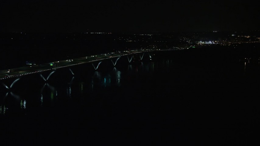 5K stock footage aerial video of light traffic on Woodrow Wilson Memorial Bridge over the Potomac River, Fort Washington, Maryland, night Aerial Stock Footage | AX77_020