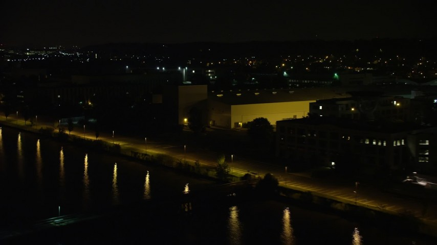 5K aerial video flying by the United States Naval Research Laboratory by the Potomac River, Washington, D.C., night Aerial Stock Footage | AX77_021