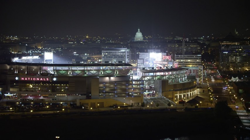 5K aerial video of Nationals Park and United States Capitol, Washington, D.C., night Aerial Stock Footage | AX77_024