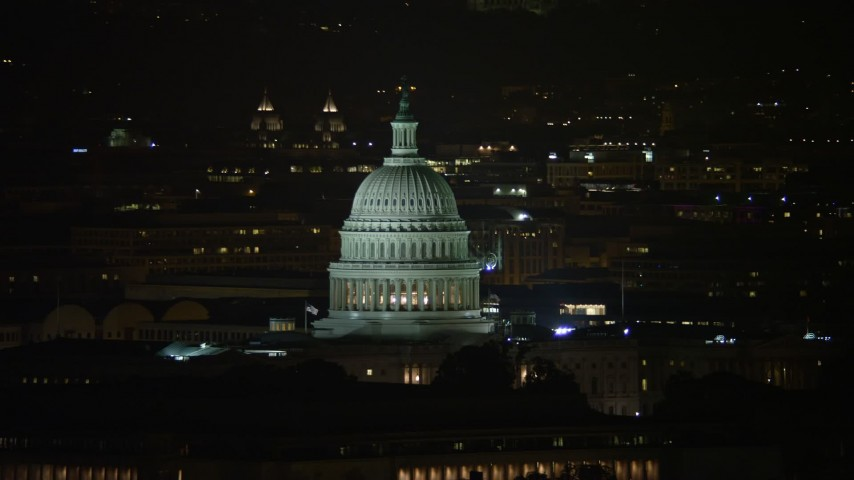 5K stock footage aerial video of the United States Capitol and Thomas Jefferson Building domes in Washington, D.C., night Aerial Stock Footage | AX77_030E