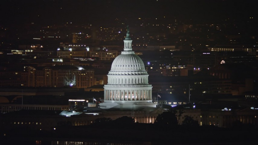 5K stock footage aerial video of the dome of the United States Capitol building in Washington, D.C., night Aerial Stock Footage | AX77_033
