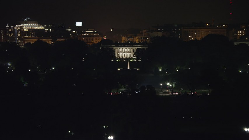5K stock footage aerial video of The White House and the South Lawn Fountain in Washington, D.C., night Aerial Stock Footage | AX77_044