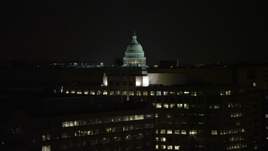 5K stock footage aerial video of the United States Capitol dome and office buildings in Washington, D.C., night Aerial Stock Footage AX77_046 | Axiom Images