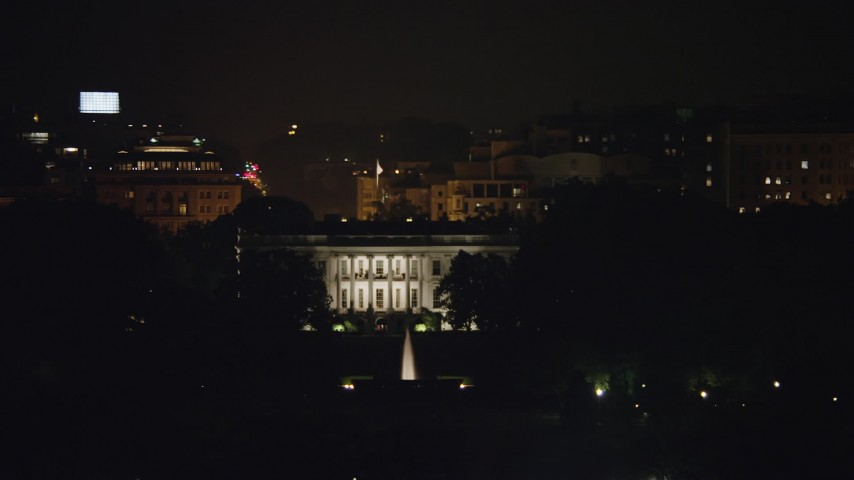 5K stock footage aerial video of The White House seen from the base of the Washington Monument, Washington, D.C., night Aerial Stock Footage | AX77_047