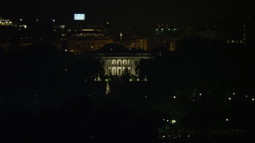 5K stock footage aerial video of The White House seen from the base of the Washington Monument, Washington, D.C., night Aerial Stock Footage | AX77_047E
