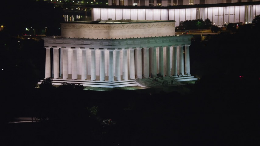 5K stock footage aerial video of tourists visiting the Lincoln Memorial, National Mall, Washington, D.C., night Aerial Stock Footage | AX77_050