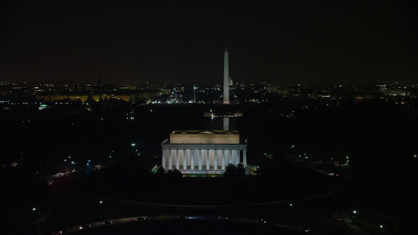 5K stock footage aerial video of Lincoln Memorial, Washington Monument, and the United States Capitol, Washington, D.C., night  Aerial Stock Footage | AX77_051