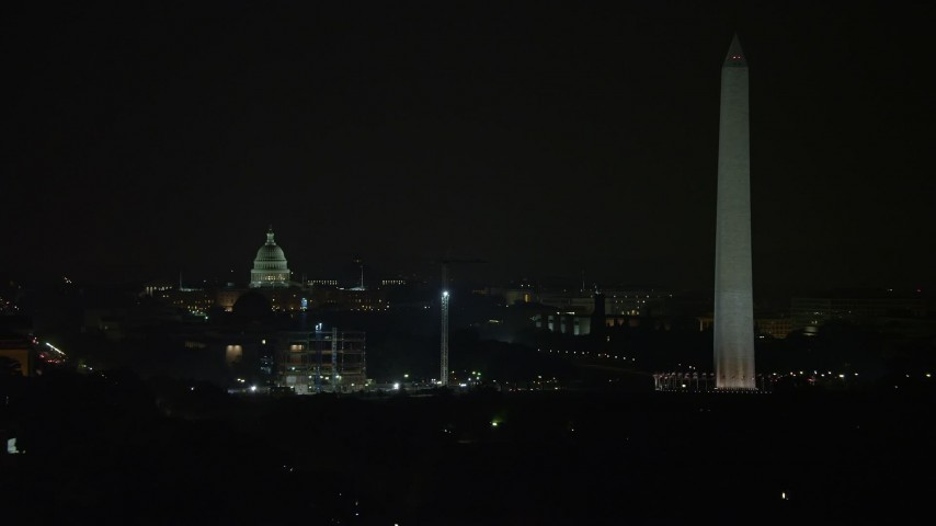 5K stock footage aerial video of the United States Capitol Building and the Washington Monument, Washington, D.C., night Aerial Stock Footage | AX77_053