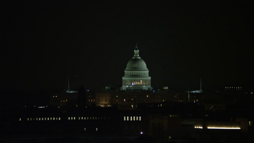 5K stock footage aerial video of the United States Capitol building in Washington, D.C., night Aerial Stock Footage | AX77_054