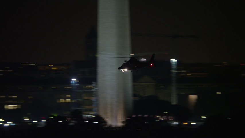 5K stock footage aerial video tracking a helicopter flying over National Mall, Washington, D.C., night Aerial Stock Footage | AX77_055