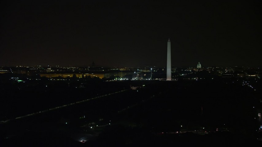 5K stock footage aerial video of Washington Monument, National Mall, Capitol Building, Lincoln Memorial, Washington, D.C., night Aerial Stock Footage AX77_058 | Axiom Images