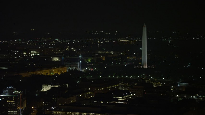 5K aerial video of the White House and the Washington Monument, reveal Jefferson Memorial in Washington, D.C., night Aerial Stock Footage | AX77_064