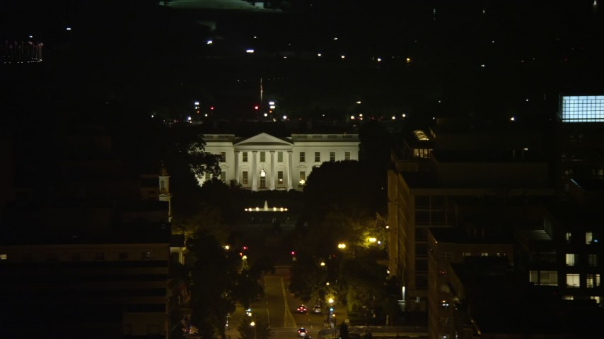 5K aerial video of The White House, tilt to reveal Washington Monument and Jefferson Memorial, Washington, D.C., night Aerial Stock Footage | AX77_065