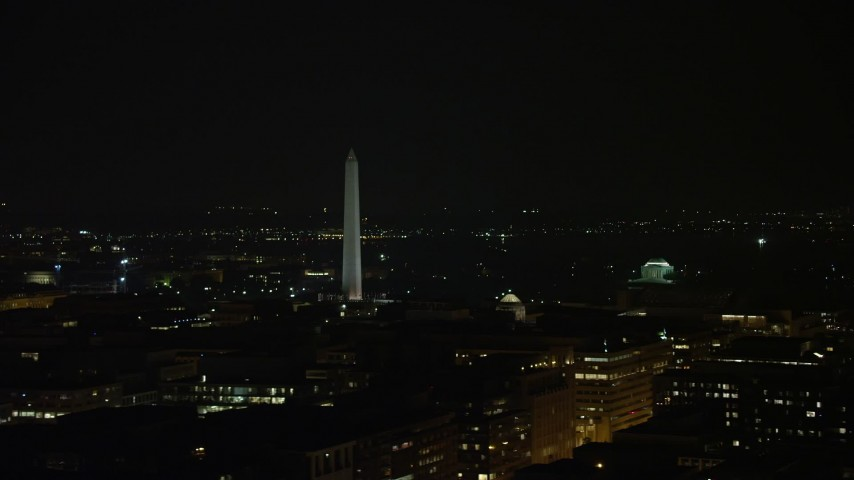 5K stock footage aerial video of Washington Monument and the Jefferson Memorial in Washington, D.C., night Aerial Stock Footage | AX77_066