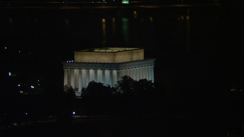 5K stock footage aerial video of the Lincoln Memorial with Tidal Basin in the background, Washington, D.C., night Aerial Stock Footage | AX77_068