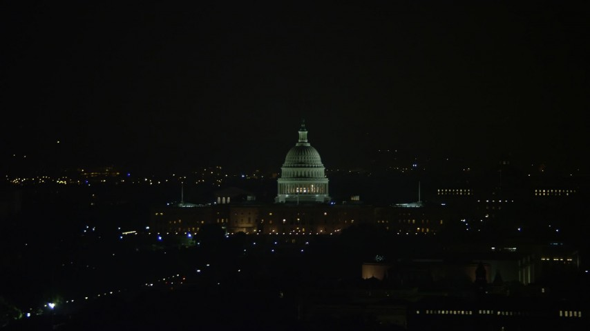 5K stock footage aerial video of the United States Capitol Building and dome in Washington, D.C., night Aerial Stock Footage | AX77_071