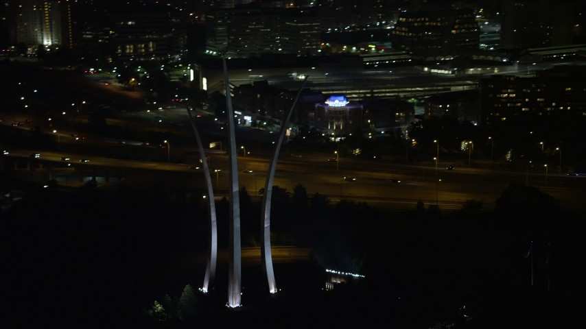 5K stock footage aerial video flying by United States Air Force Memorial, Arlington National Cemetery, Arlington, Virginia, night Aerial Stock Footage | AX77_073