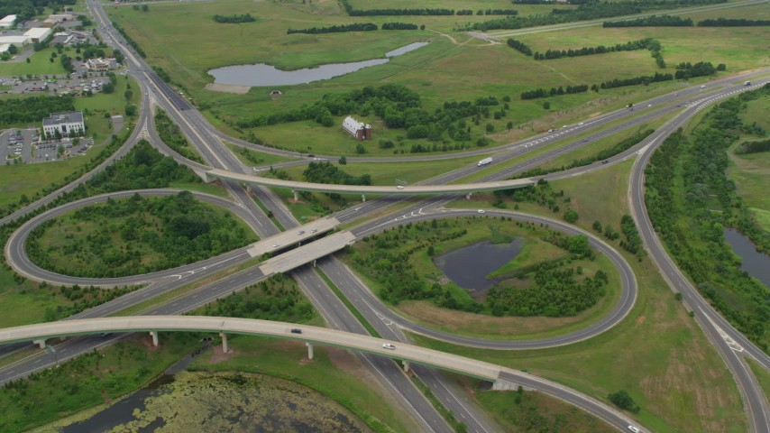 5K stock footage aerial video of light traffic on interchange between Prince William Parkway and Nokeville Road, Manassas, Virginia Aerial Stock Footage | AX78_002