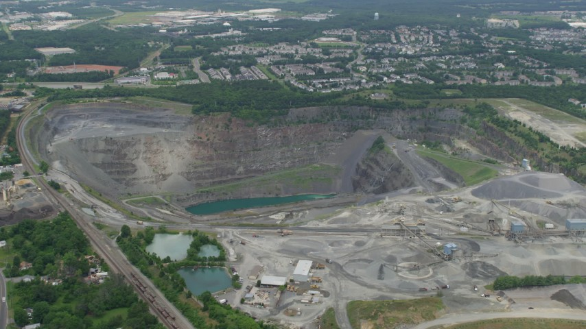 5K stock footage aerial video approaching Vulcan Lake at the bottom of a quarry in Manassas, Virginia Aerial Stock Footage | AX78_005