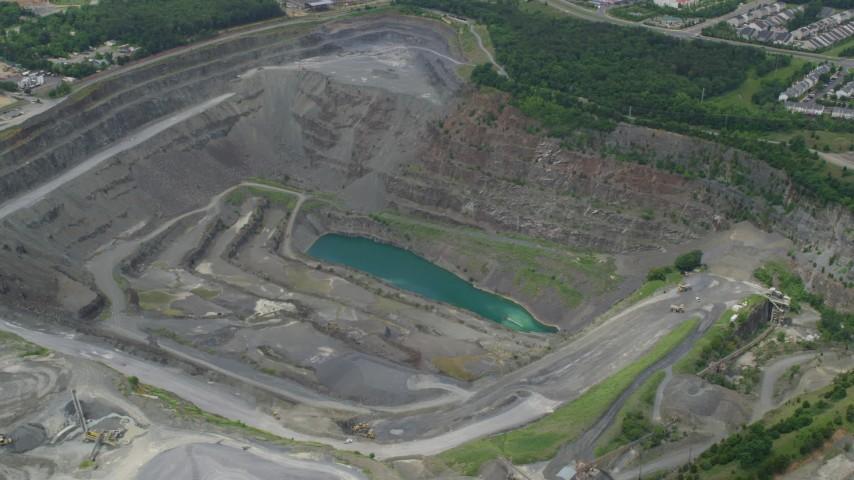 5K stock footage aerial video of Vulcan Lake in a quarry in Manassas, Virginia Aerial Stock Footage | AX78_007