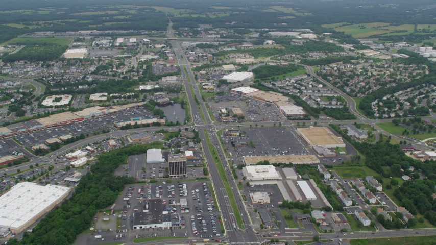 5K stock footage aerial video of strip malls and shopping centers by Sudley Manor Drive in Manassas, Virginia Aerial Stock Footage | AX78_008