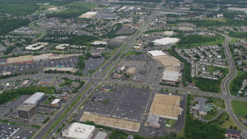 5K stock footage aerial video of strip malls and shopping centers around busy intersection in Manassas, Virginia Aerial Stock Footage | AX78_009