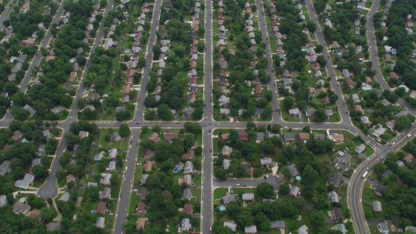 5K stock footage aerial video of suburban streets and neighborhoods with trees, Manassas, Virginia Aerial Stock Footage   AX78_010