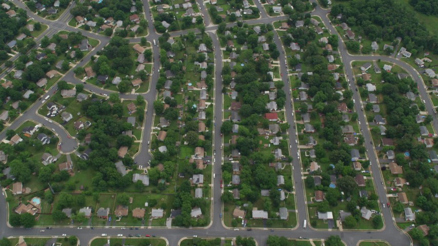 5K stock footage aerial video of a bird's eye view of suburban homes, streets, and trees, Manassas, Virginia Aerial Stock Footage | AX78_011