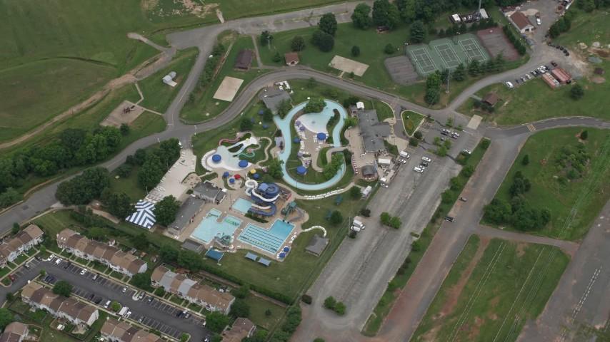 5K stock footage aerial video of a bird's eye view of Splash Down Waterpark, Manassas, Virginia Aerial Stock Footage | AX78_012