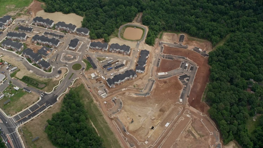 5K stock footage aerial video of a bird's eye view of apartment buildings and construction in Manassas, Virginia Aerial Stock Footage | AX78_014