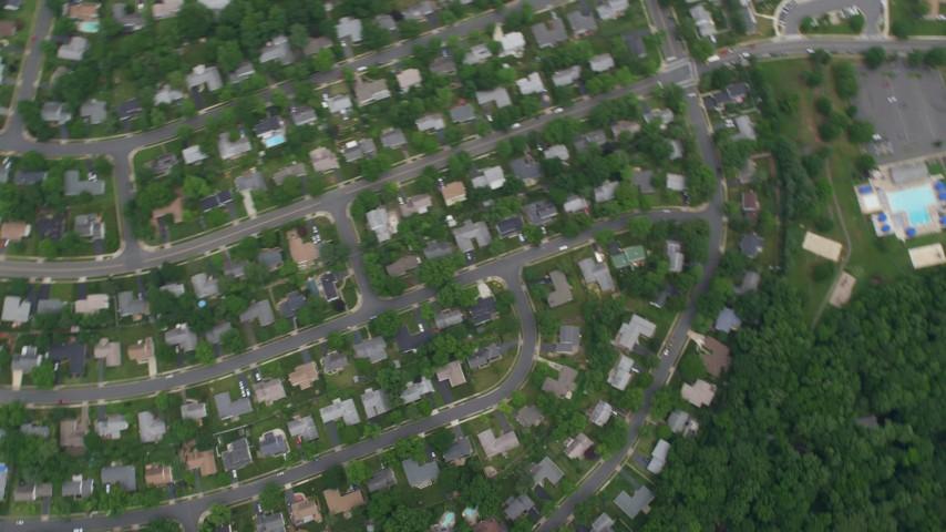 5K aerial video of a bird's eye view of suburban neighborhoods, Greenbriar East Elementary School, Fairfax, Virginia Aerial Stock Footage | AX78_021