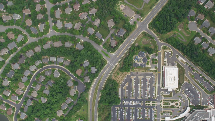 5K aerial video of a bird's eye view of homes, Fair Oaks Hospital, reveal Navy Elementary School in Fairfax, Virginia Aerial Stock Footage | AX78_024