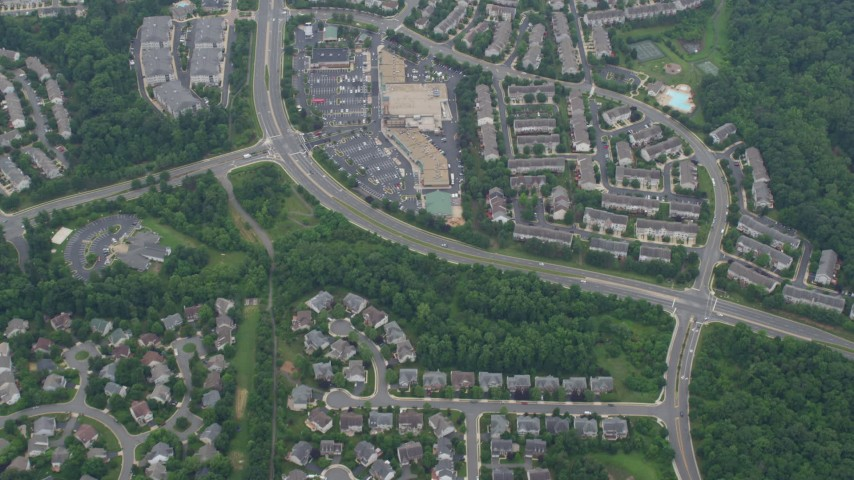 5K aerial video of a reverse view of Great Falls Plaza and tract homes in Sterling, Virginia Aerial Stock Footage | AX78_039