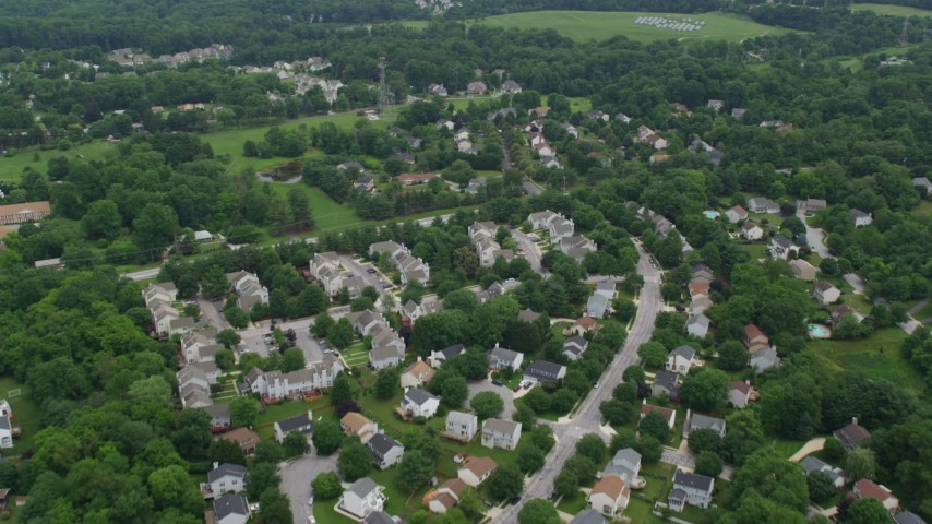 5K aerial video flying over suburban neighborhoods in Ellicott City, Maryland Aerial Stock Footage | AX78_072