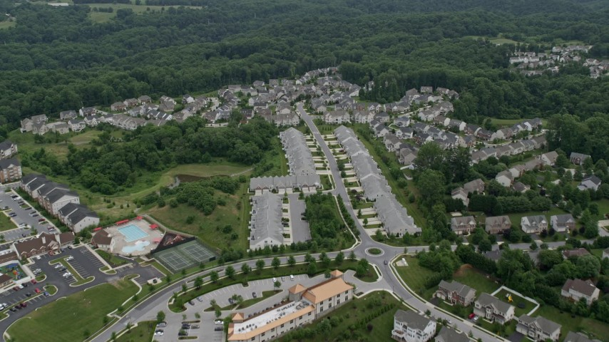 5K aerial video of town homes and forest in Ellicott City, Maryland Aerial Stock Footage | AX78_074