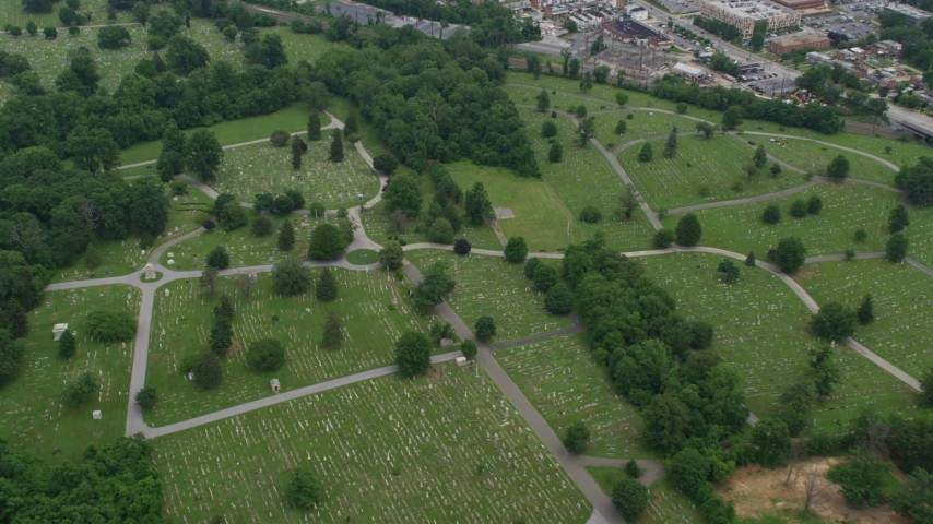 5K stock footage aerial video tilting to gravestones at Loudon Park Funeral Home and Cemetery in Baltimore, Maryland Aerial Stock Footage | AX78_082