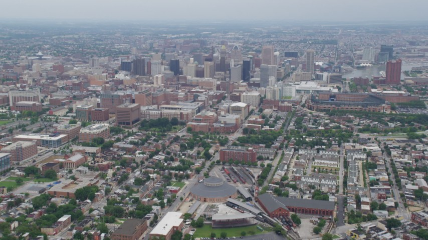5K stock footage aerial video flying over urban neighborhoods to approach Downtown Baltimore skyscrapers, Maryland Aerial Stock Footage | AX78_085